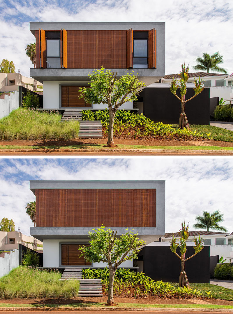 Carolina Sakuno and Fausto Cintra of CF Arquitetura have designed this contemporary home for a young family in Londrina, Brazil. From the street, the two-storey house has large wooden shutters on the upper floor that provide privacy and security, while landscaping guides you to the wooden front door.