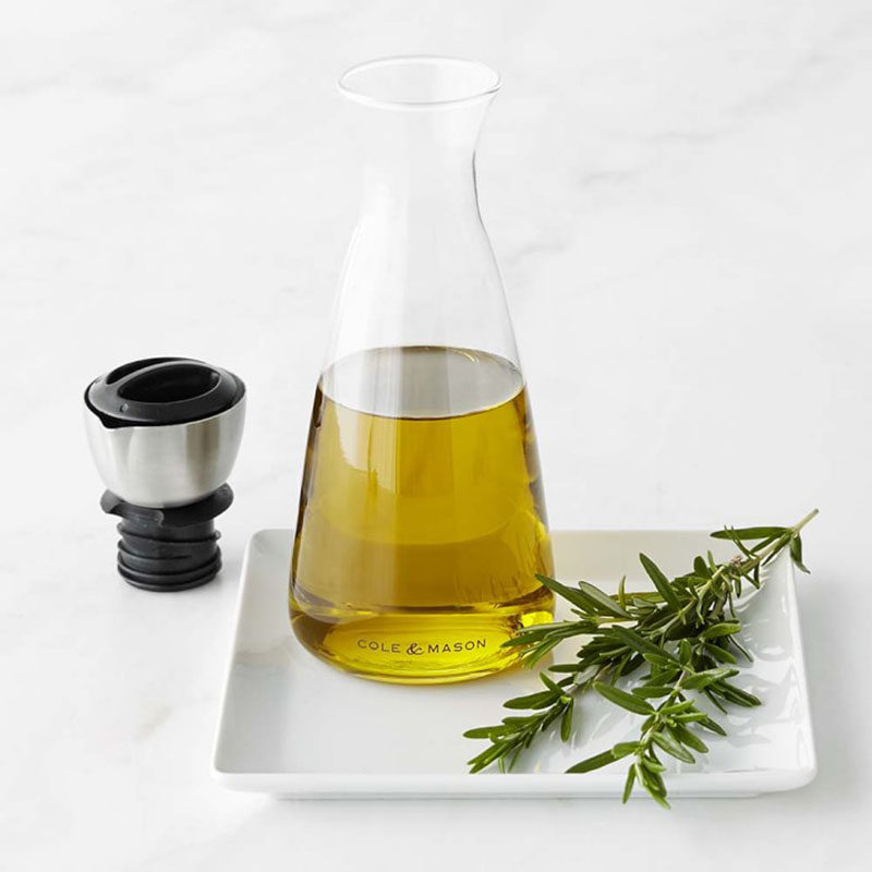 Essential Kitchen Tools - 11 Creative Oil & Vinegar Dispensers // A simple beaker style jug with an adjustable spout means you'll get the perfect amount of oil every time.