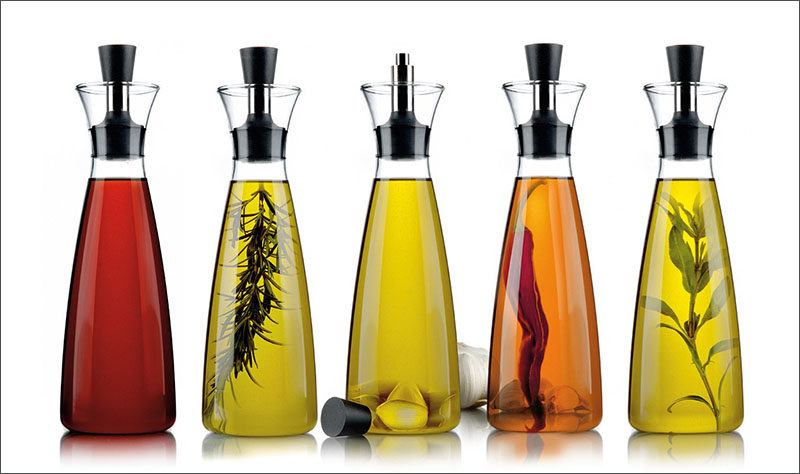 Essential Kitchen Tools - 11 Creative Oil & Vinegar Dispensers // Tall oil dispensers like these are perfect for adding herbs and other things to infuse your oil at home and makes the display much nicer to look at.