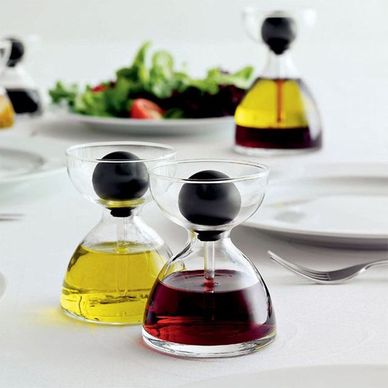 Essential Kitchen Tools - 11 Creative Oil & Vinegar Dispensers // Inject just a little bit of oil into your cooking with these oil holders that use a pipette to dispense the oil.