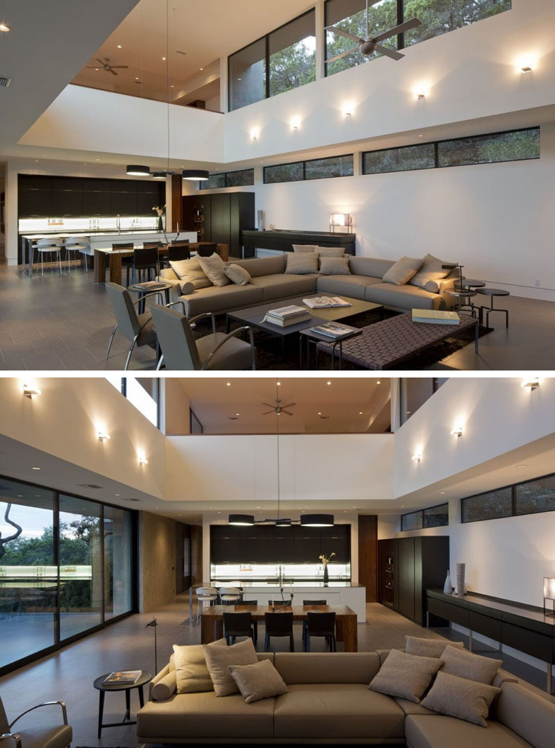 Inside this home, the main living and dining area has a double height ceiling making the space feel large and open.