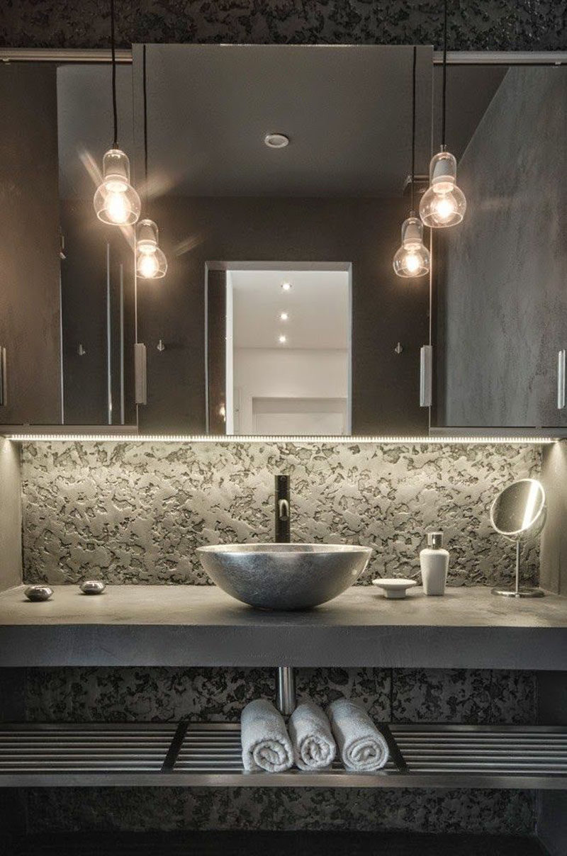 Bathroom Design Ideas - Open Shelf Below The Countertop // The dark colors used in this bathroom and the metal shelf under the sink give this bathroom an industrial look.