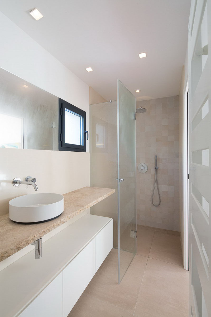 Bathroom Design Ideas - Open Shelf Below The Countertop // A shelf under the sink that also has cupboards is a great storage solution for small bathrooms like this one.