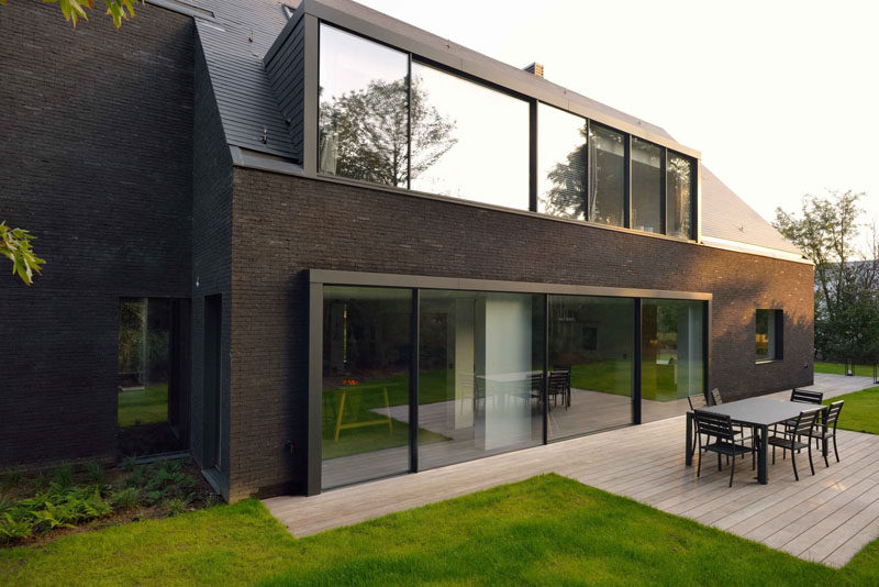 Just off the dining room of this modern home is a deck area with space for an outdoor dining area.