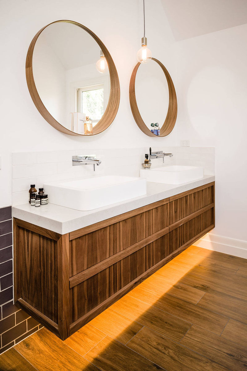 5 Bathroom Mirror Ideas For A Double Vanity // Two circular mirrors are a simple way to make your bathroom slightly more unique and can break up a bathroom dominated by hard, solid lines.