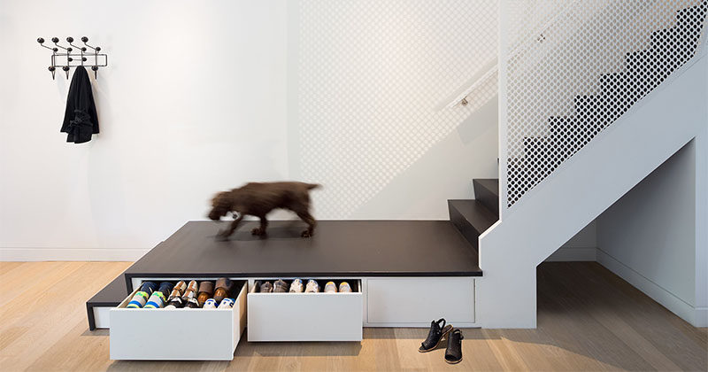 Design idea for stairs this stair landing has hidden shoe storage contemporist for Home designer stairs with landing