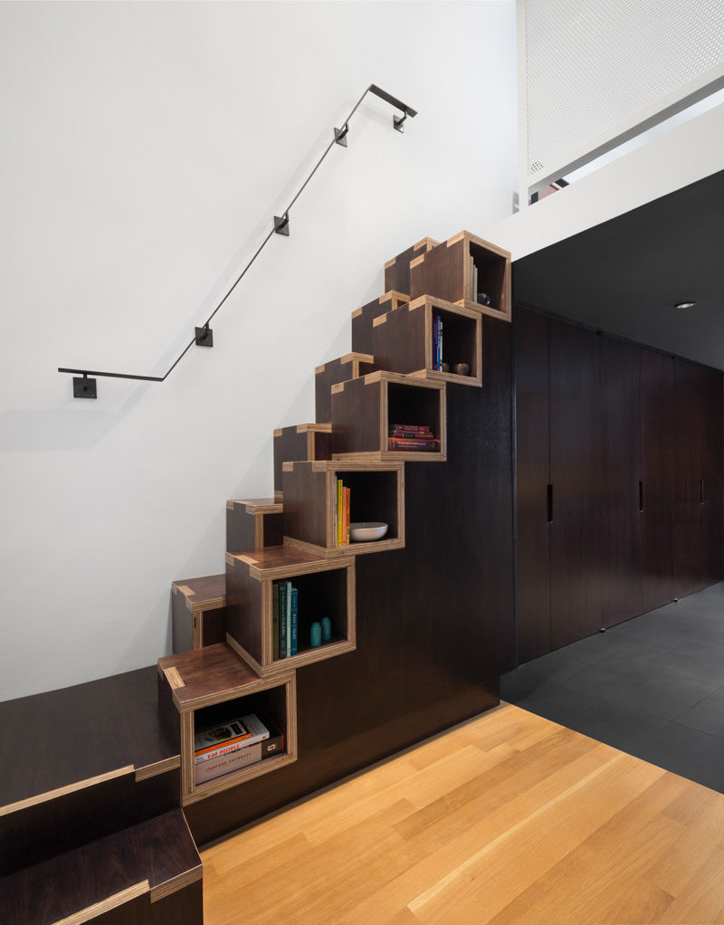13 Stair Design Ideas For Small Spaces // These staggered wooden stairs also double as convenient shelving thanks to their cubby-like form.