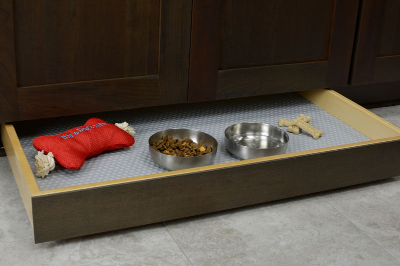Kitchen Design Idea - Toe Kick Drawers // They are ideal for a pet food station.