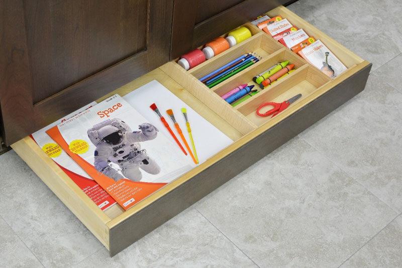 Kitchen Design Idea - Toe Kick Drawers // Perfect spot for childrens craft storage