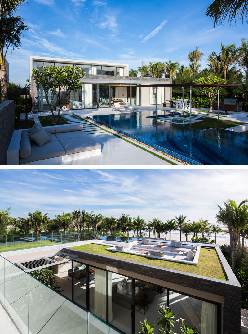 14 Examples Of Modern Beach Houses // Not only can the beach be seen from the interior of this Vietnamese beach house but the roof of the house, featuring the perfect party location, also offers views of the nearby ocean.