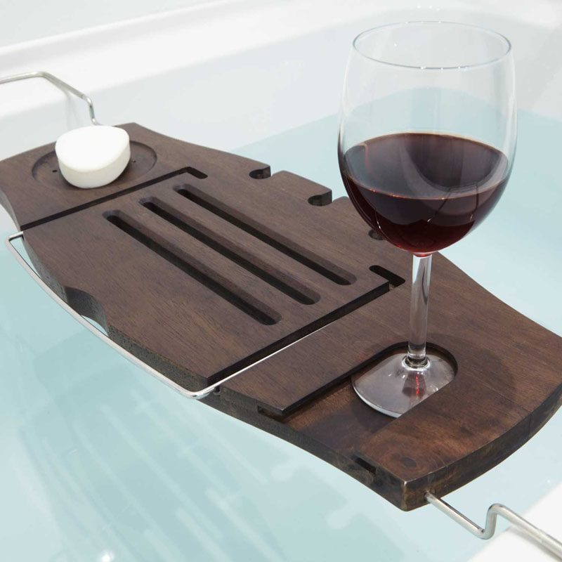 7 Things You Need To Create The Perfect Spa at Home // A bath caddy with a few cut outs lets you bring all your essentials into the tub with you.