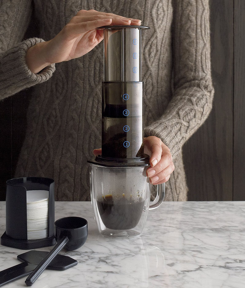 13 Modern Gift Ideas For Coffee Connoisseurs // The AeroPress coffee maker sits right on top of your mug and puts you in control of the whole coffee making process.