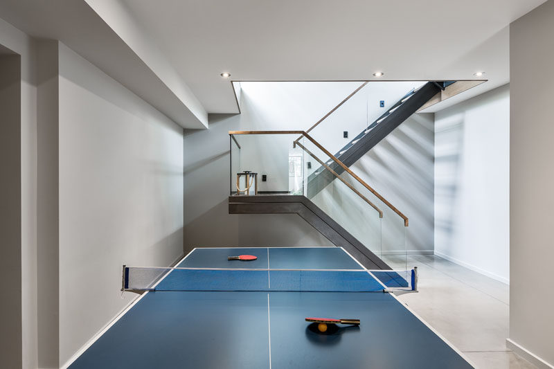 The basement of this contemporary home has been set up as a games room and play space for children.