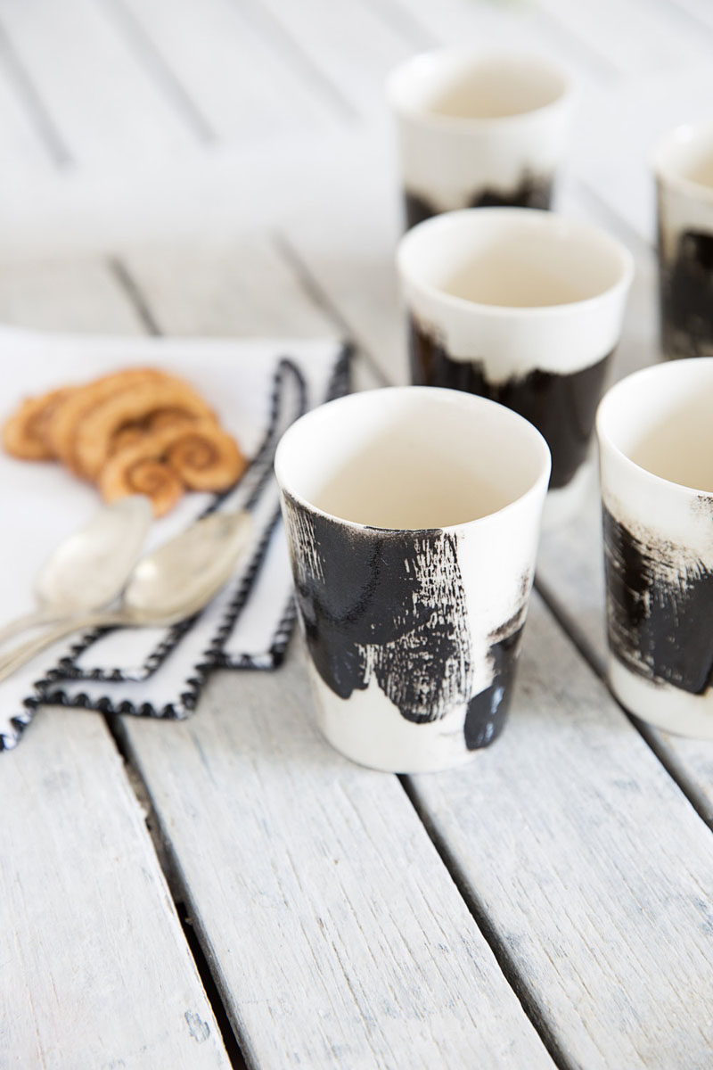 Mini black and white ceramic espresso cups.