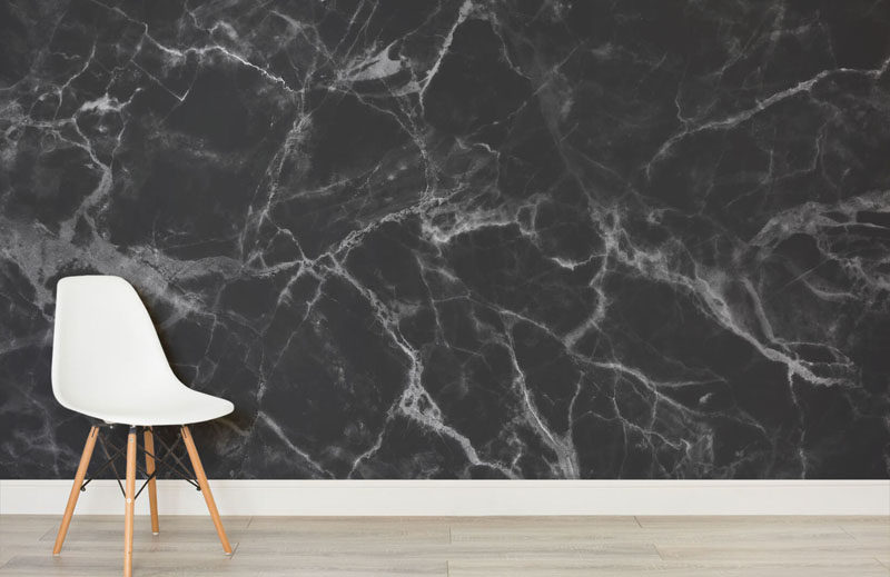 8 Examples Of Modern Marble Wallpaper // Make a dramatic statement with a bold black marble wall with white veins running throughout it.