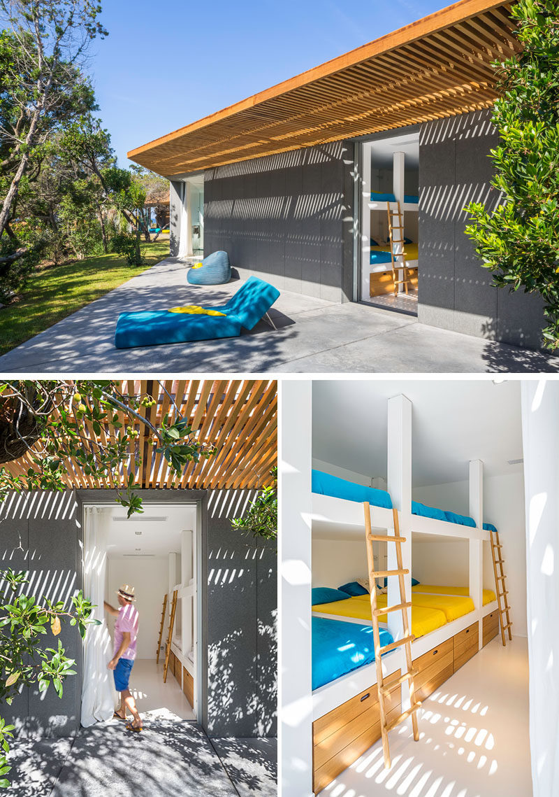 This modern villa has a bedroom filled with bunk beds and additional storage.