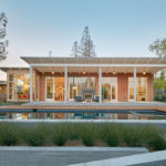 This wood clad and sloped roof modern house was designed for life in California's Silicon Valley