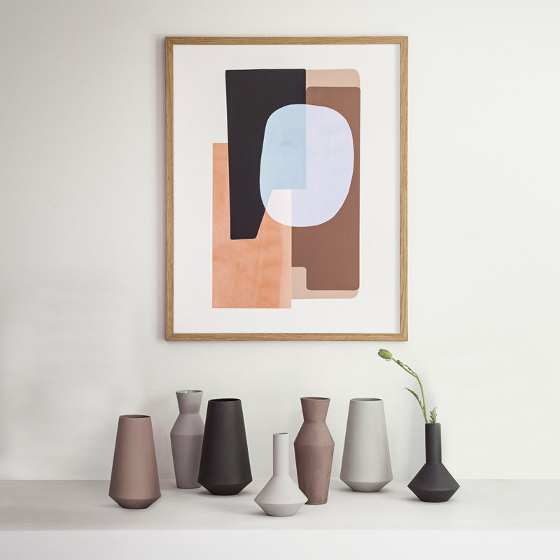 Matte ceramic vases in different shapes and colors create a dynamic display.