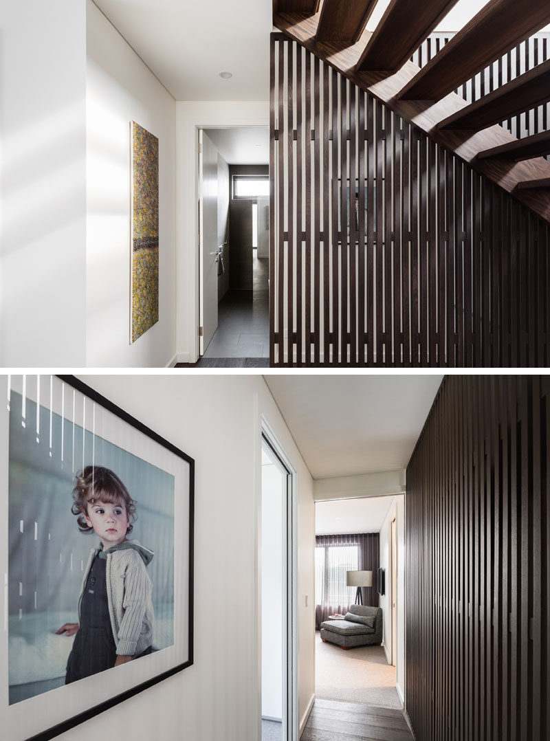 This contemporary home has multiple hallways, one provides access to the front door, while another runs alongside the stairs to a bedroom.