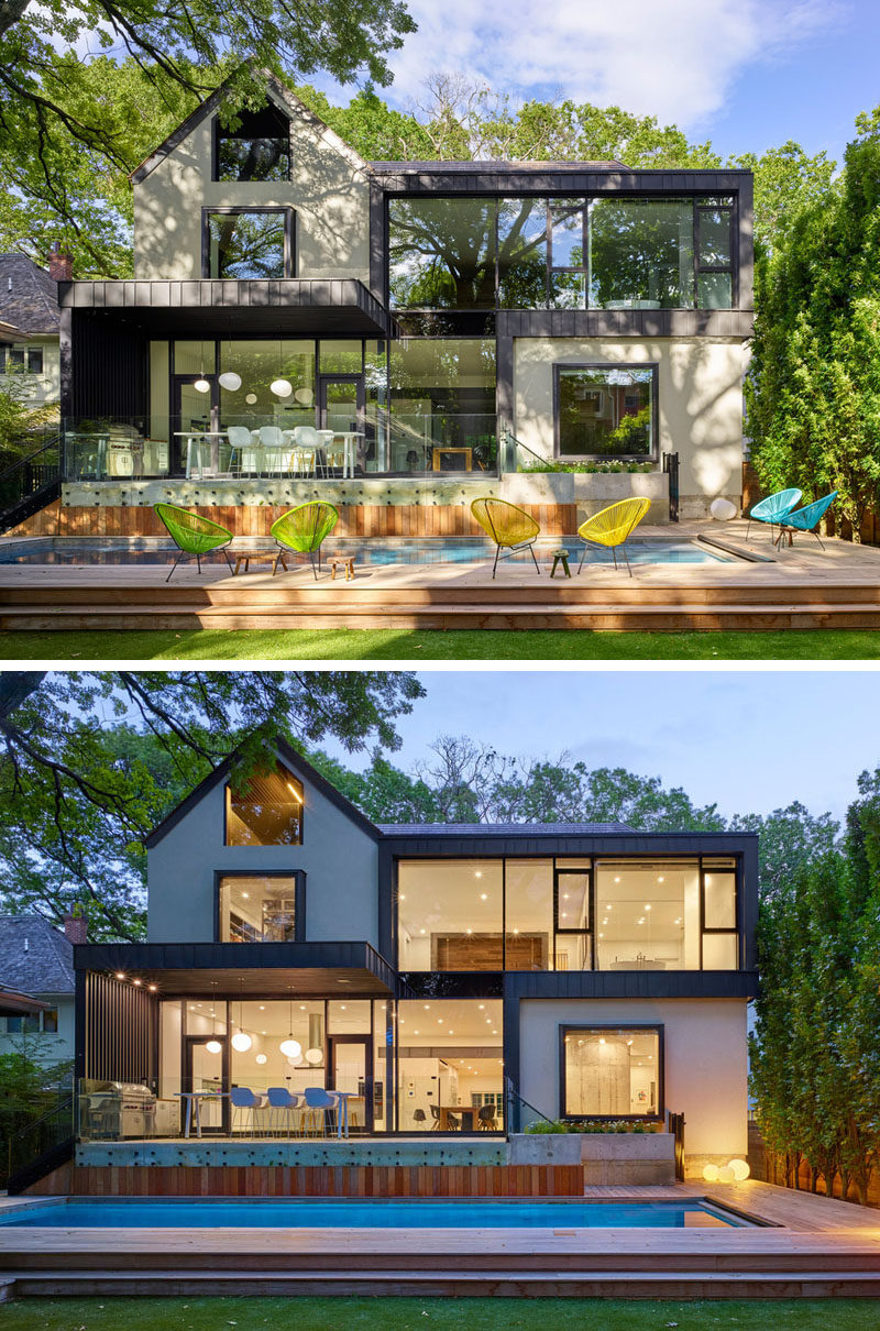 The rear of this home received a contemporary extension with large floor-to-ceiling windows positioned to frame trees the in the backyard.