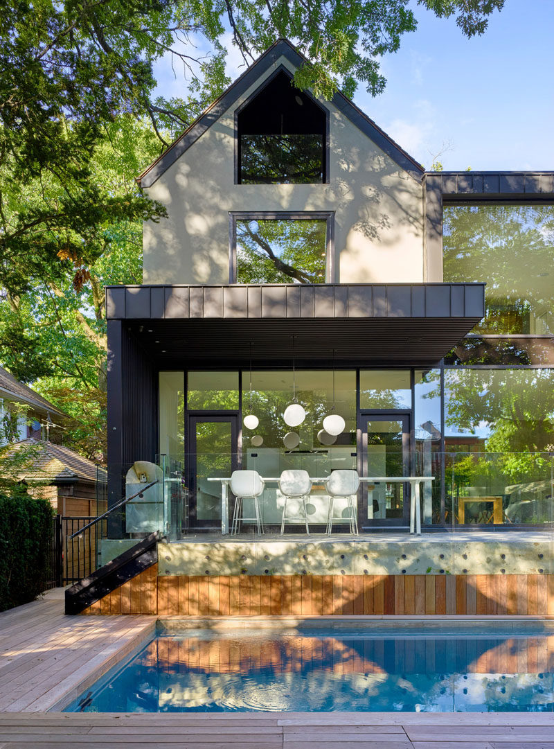 A peaked gable end on this renovated house pays homage to the architecture of other homes in the neighborhood.