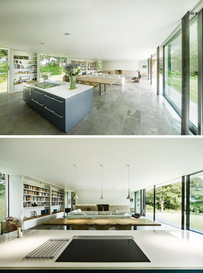 Inside this home, the main living area is open plan, with the kitchen, dining and living room all sharing the same space. Large windows and sliding glass doors make the entire space feel bright and airy.