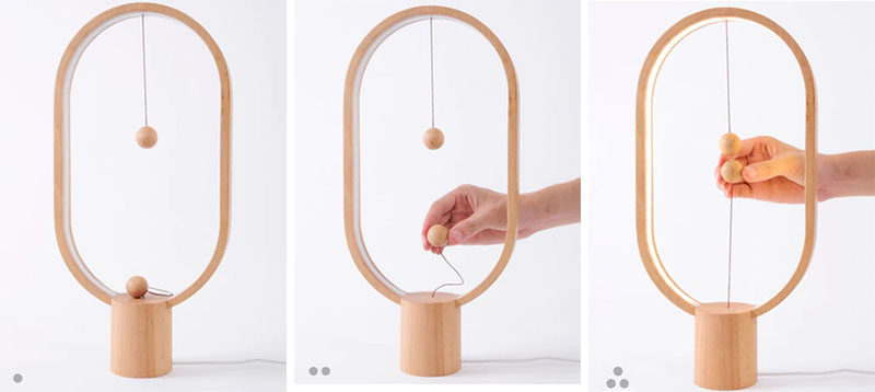 The Heng Balance Lamp, designed by Li Zanwen, is a table lamp made from high quality wood and two magnetic balls attached to an internal switch that's designed to make brightening all of your spaces a little more fun and a little less mundane.