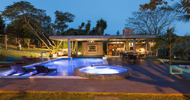 This Tropical Pool House Has A Swim Up Bar And A Glass ...