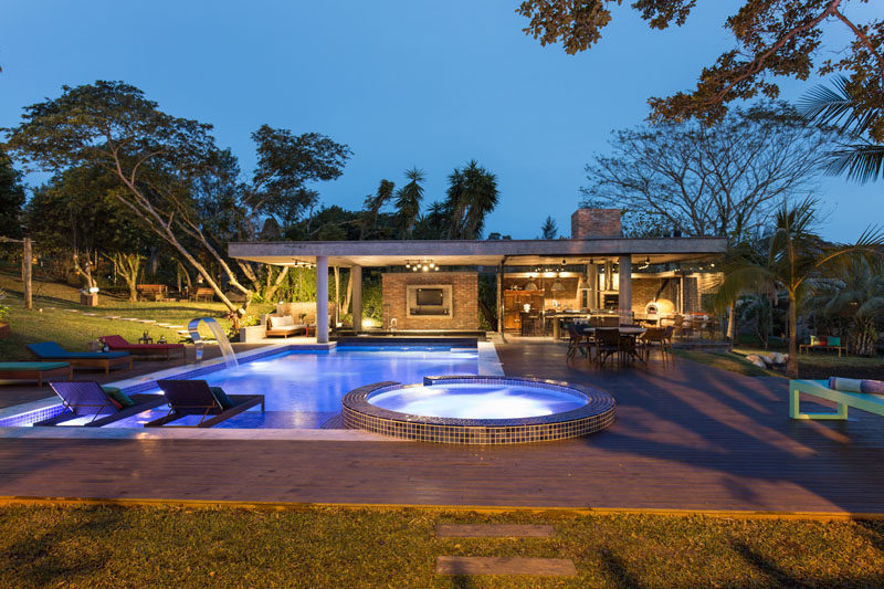 This Tropical Pool House Has A Swim Up Bar And A Glass Enclosed Dining Area