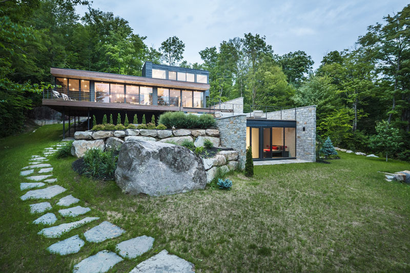 Wood And Stone House wood and stone cover the exterior of this multi-level modern house
