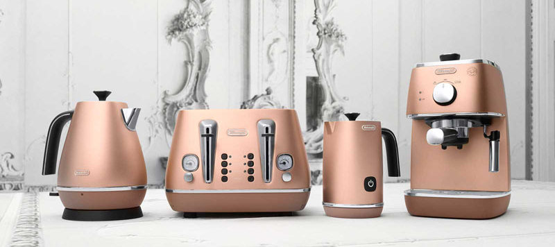 Kitchen Decor Ideas - 12 Ways To Add Copper To Your Kitchen // Make your breakfast in style with this entire copper series that includes two kinds of kettles, a toaster and an espresso machine.