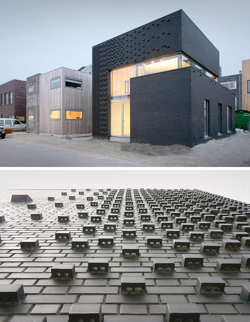 Dark bricks on the exterior of this house and their unique arrangement keep this building smooth in some places and textured in others.