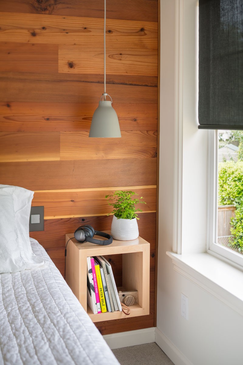 bedroom design ideas - wood accent wall behind the bed with floating Floating Wood Nightstand