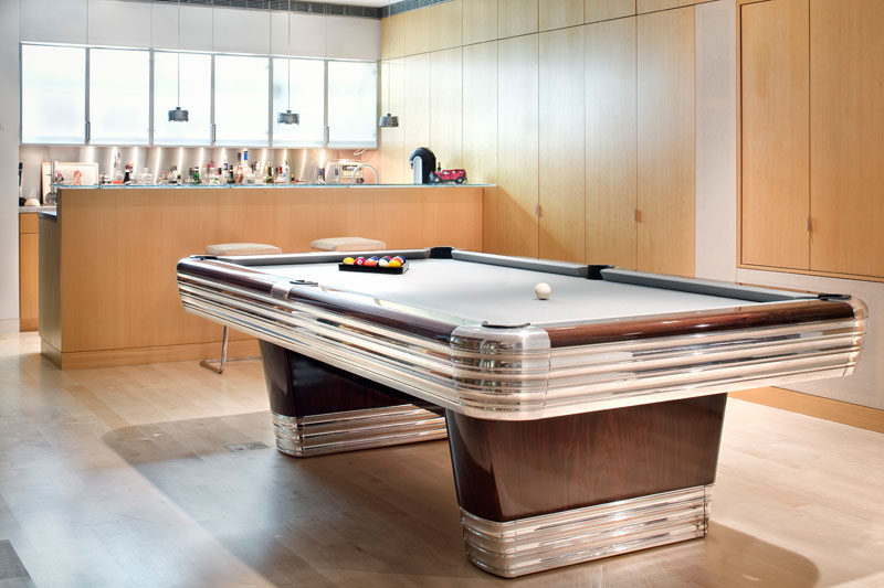 This contemporary home has a games area with pool table and bar.
