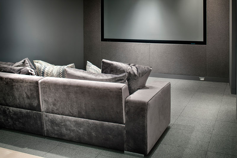 This home theater has a relaxing grey color palette.