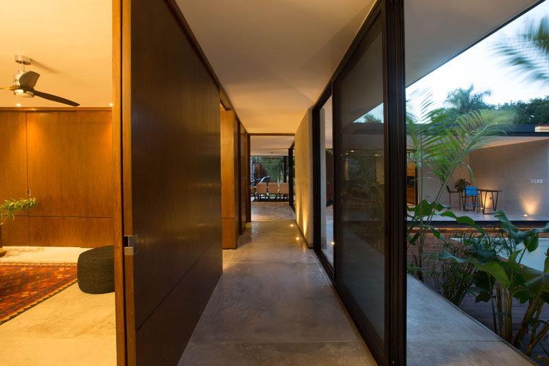 This hallway in a house in Mexico can be opened to the outdoors for an indoor/outdoor living experience.