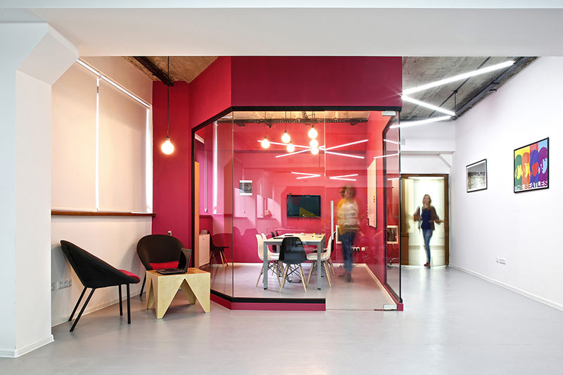 Interior Design Idea - Use Color To Define An Area // For this meeting room, the interior designers used hot pink on the exterior and interior of the room, creating a bright and bold look for the space that you can't miss.