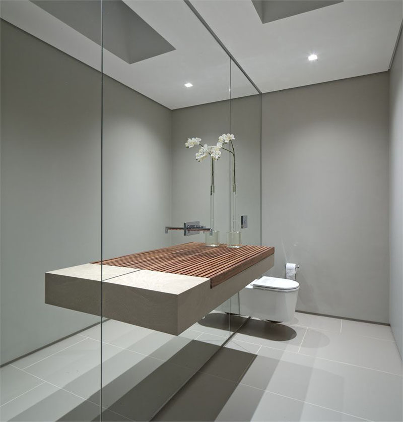 This wall of mirror makes the small bathroom seem much larger than it actually is and makes the sink appear to be a lot wider than it really is.