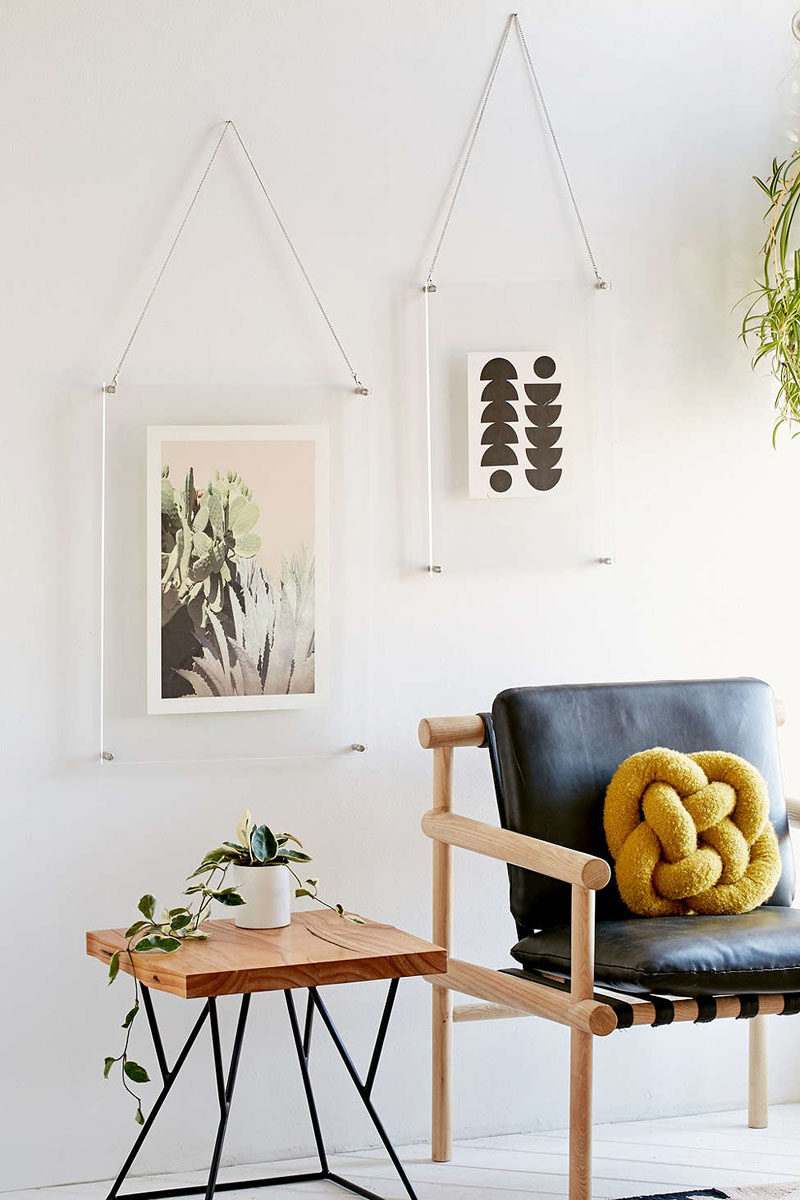 5 Ways To Use Acrylic Decor Throughout Your House // Living Room - Acrylic picture frames let your photos do all the talking and prevent the frame from stealing the show.