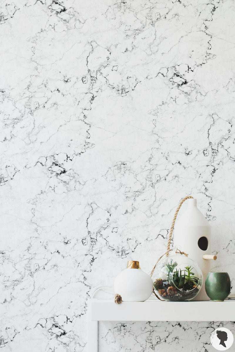 8 Examples Of Modern Marble Wallpaper // This predominantly white marble wallpaper has black veins throughout it that create a dramatic contrast that would look great partnered with simple decor.
