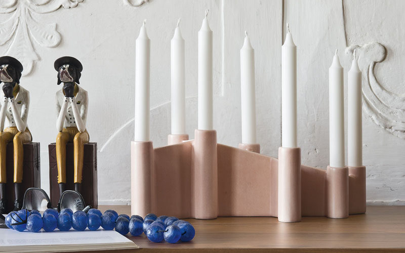 Brighten up your home with 7 candles that sit in a single ceramic holder.