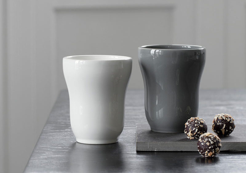 Modern ceramic mugs in grey and white with a smooth glossy finish.