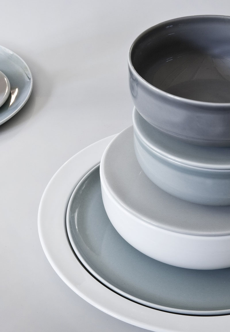 Ceramic plates with a glossy finish in muted colors.