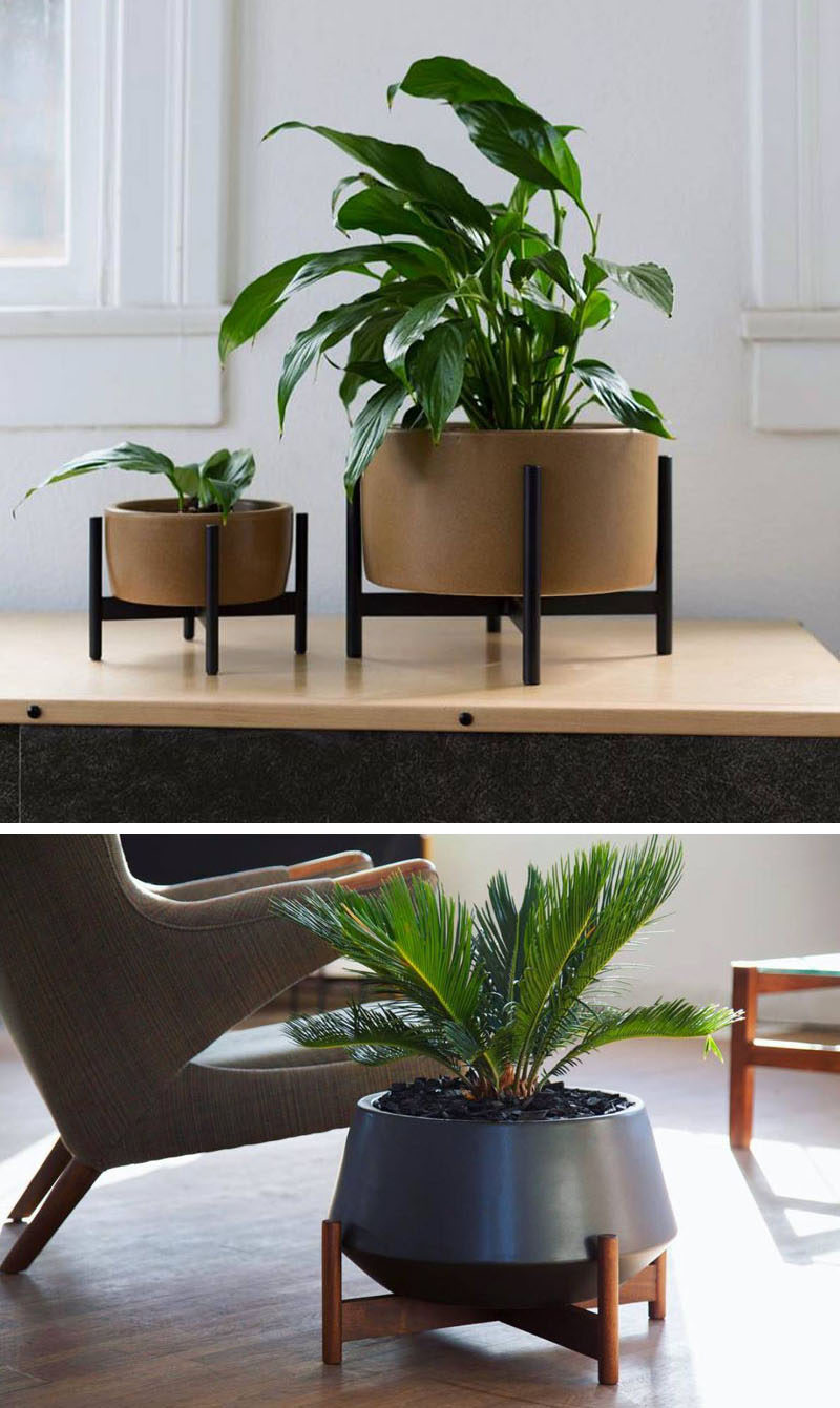 Home Decor Ideas - 6 Ways To Include Ceramic In Your Interior // These ceramic planters with wooden stands combine two natural elements and create a modern place to display your plants.