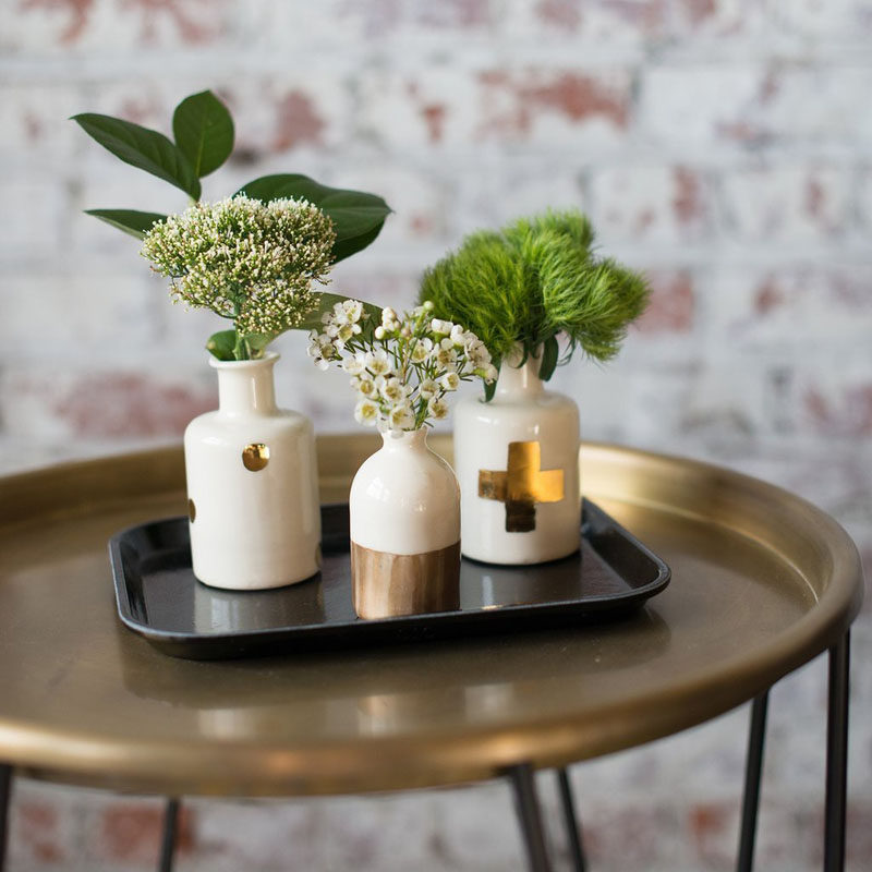 Small bud vases like these white and gold ones are great for displaying small flowers.