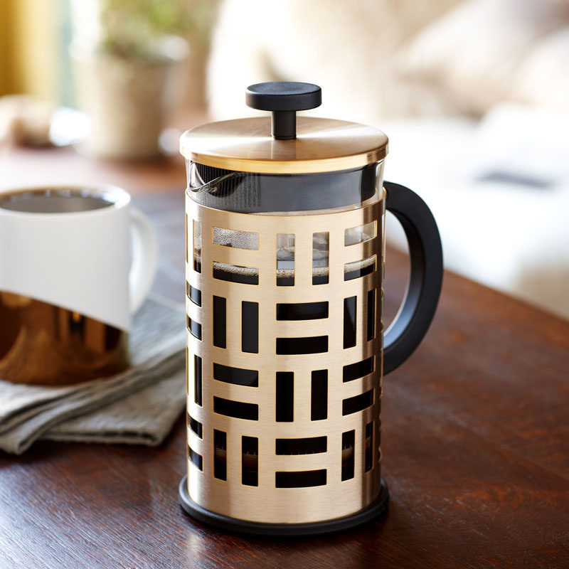 17 Modern Coffee Makers That You'll Want To Show Off // This metallic and geometric coffee press adds a sophisticated look to your coffee and turns making coffee into an elegant part of the day.
