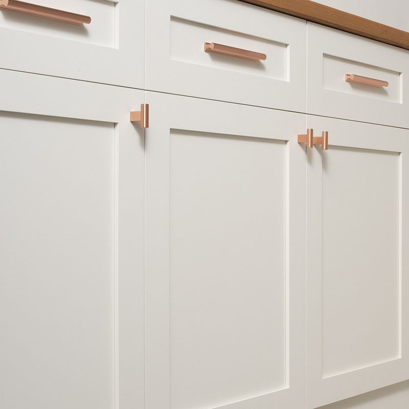 you can also use simple copper drawer pulls to tie together the other copper elements scattered throughout your kitchen
