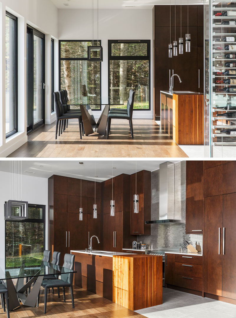 This dining area and kitchen both share the same space, with the kitchen cabinets reaching all the way to the high ceiling.