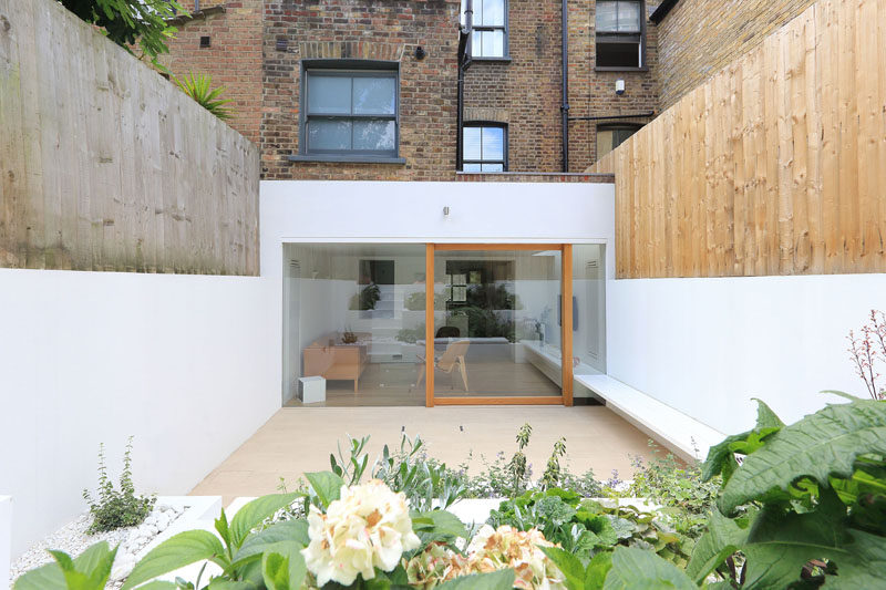 A Bright White Dining Room Extension And Landscaped Terraced Backyard Were Added To This East London Home