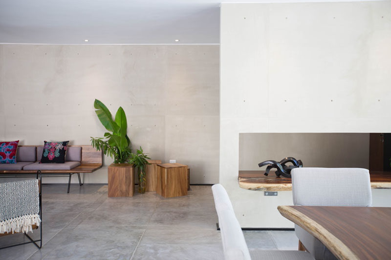Concrete walls and floors are softened by the use of wood in this home in Mexico.